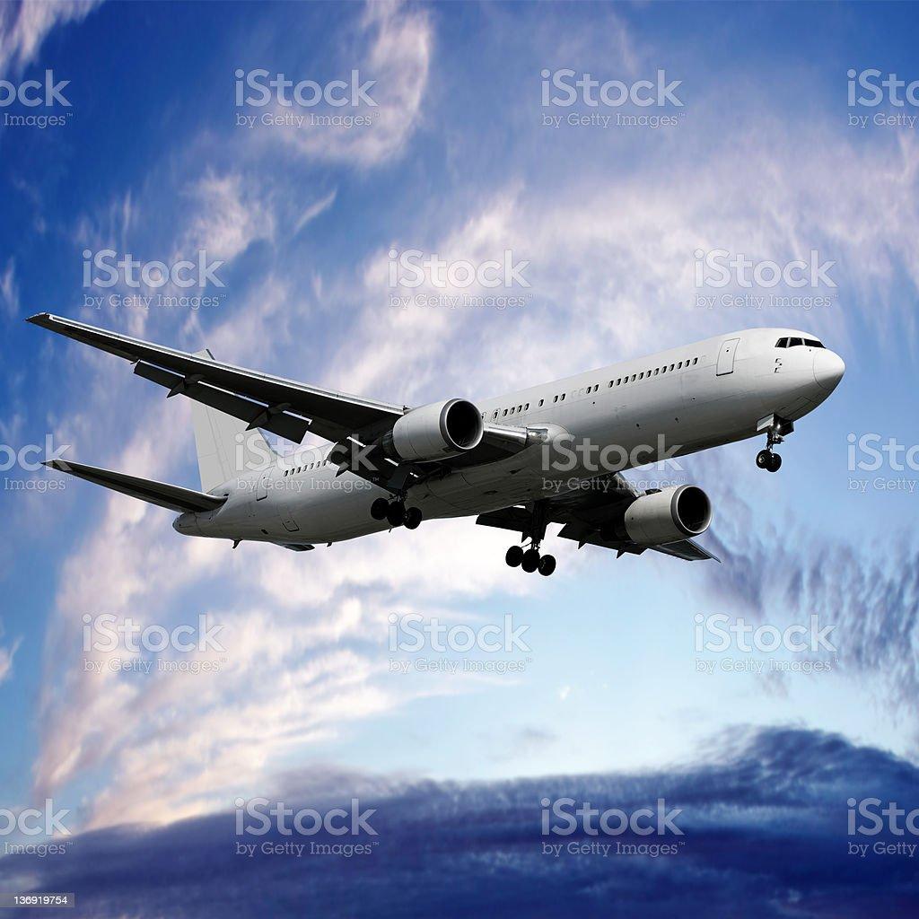 XXXL jet airplane landing at twilight royalty-free stock photo