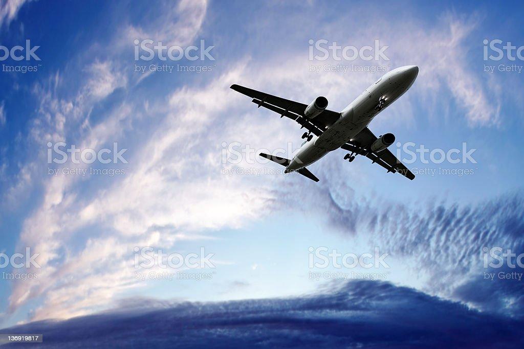jet airplane landing at twilight royalty-free stock photo