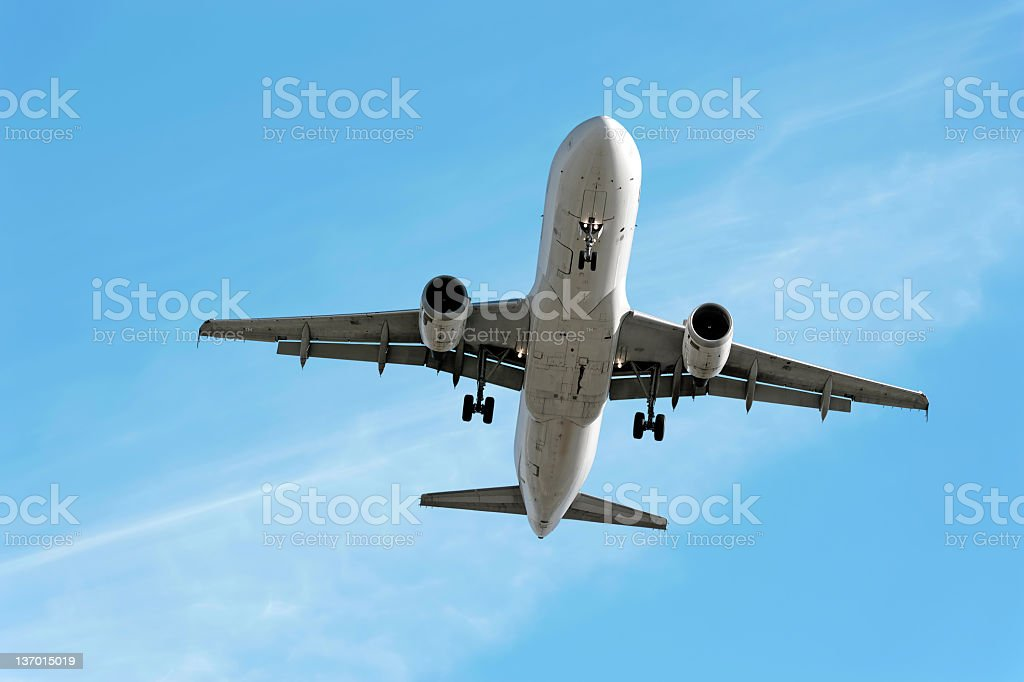 XXL jet airplane landing in bright sky royalty-free stock photo