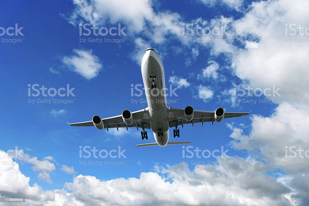XL jet airplane landing in bright sky royalty-free stock photo
