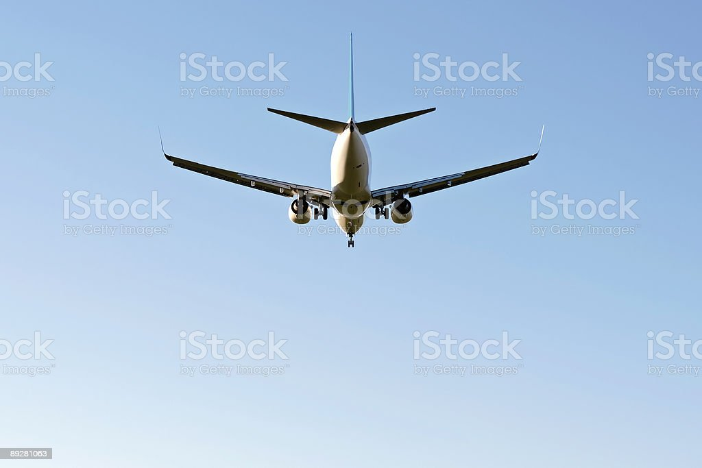 jet airplane landing in clear sky royalty-free stock photo