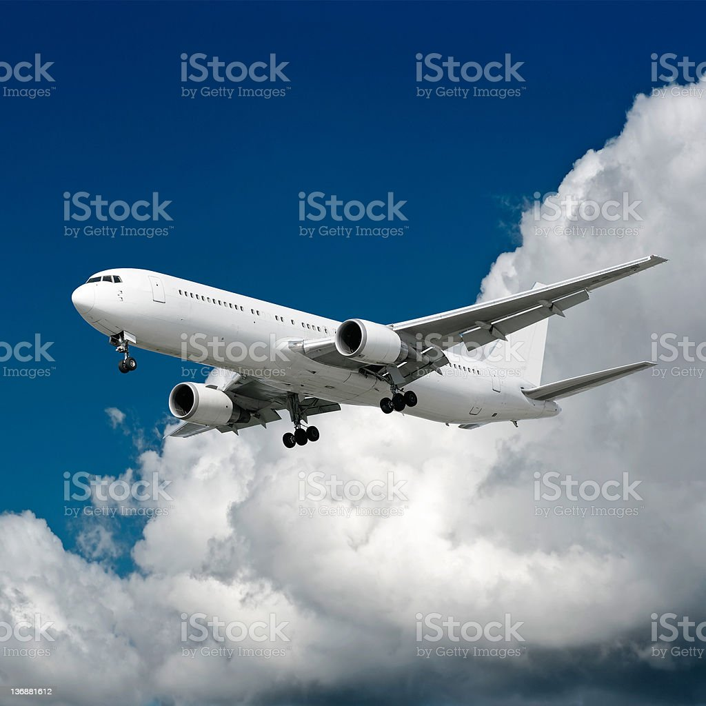 XXL jet airplane landing in cloudy sky royalty-free stock photo
