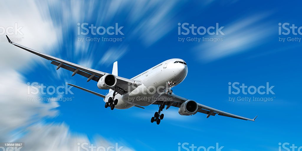 jet airplane landing in motion blur sky royalty-free stock photo