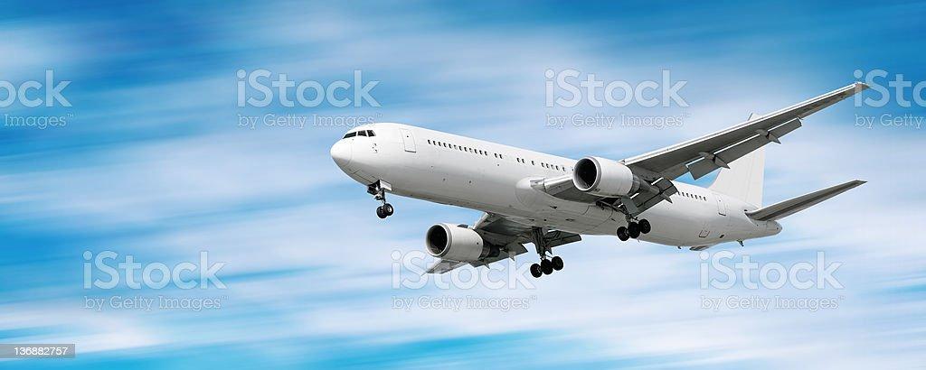 XXL jet airplane landing in motion blur sky royalty-free stock photo