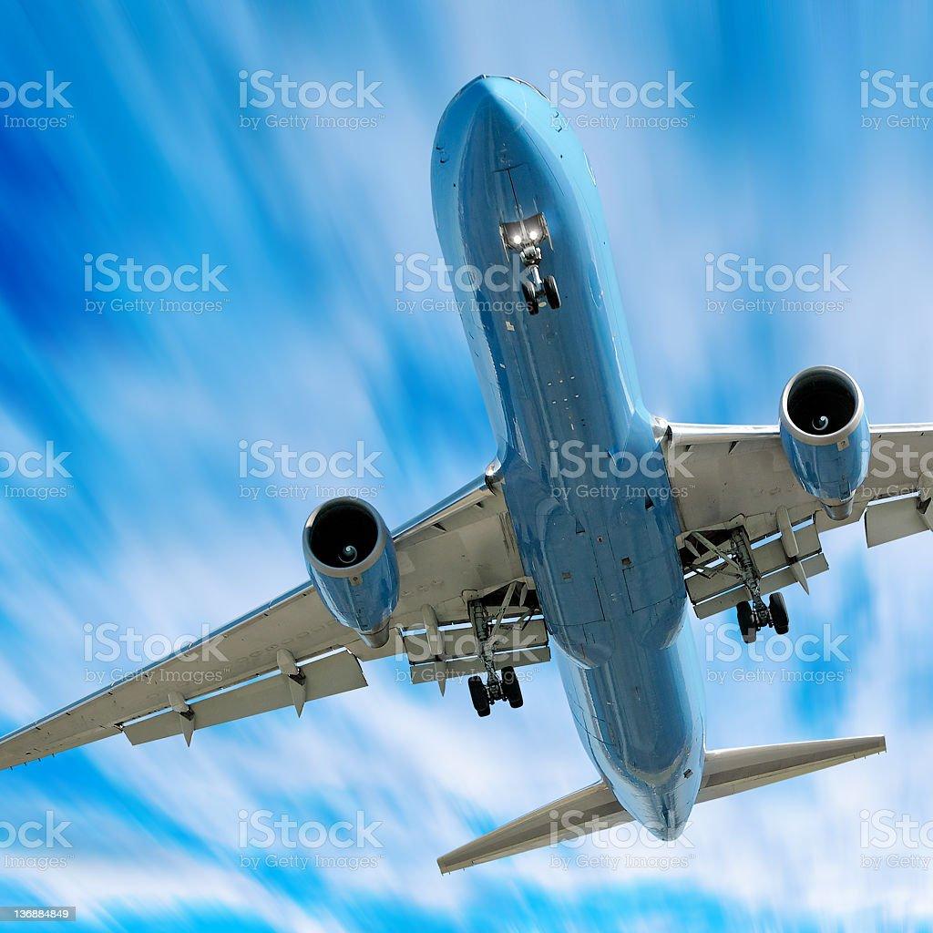 jet airplane landing in motion blur sky stock photo