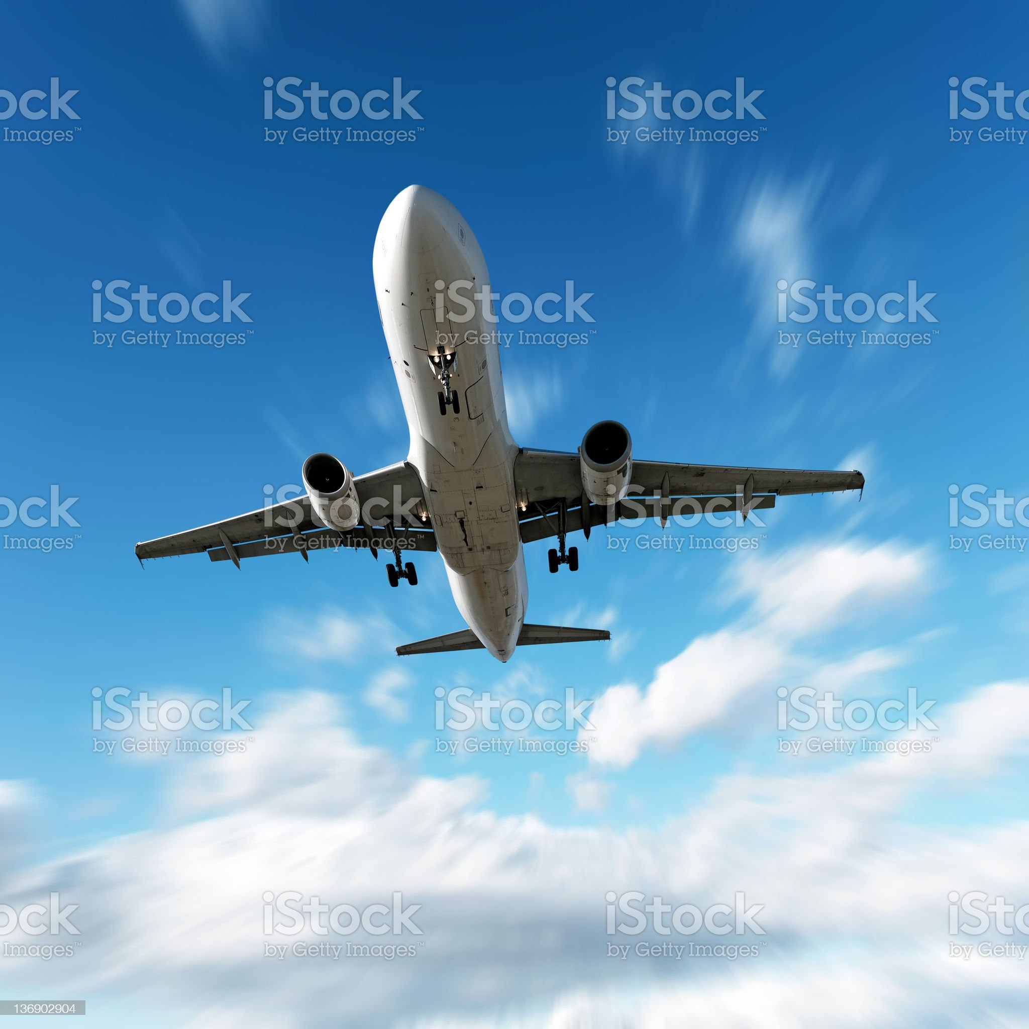 XL jet airplane landing in motion blur sky royalty-free stock photo