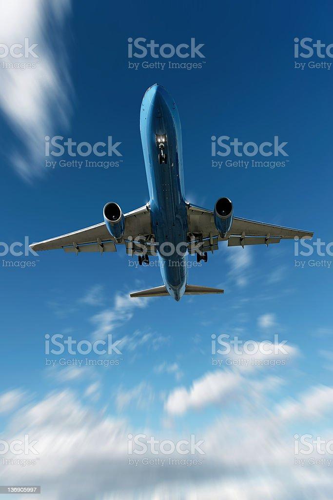 XL jet airplane landing in motion blur sky royalty-free stock photo