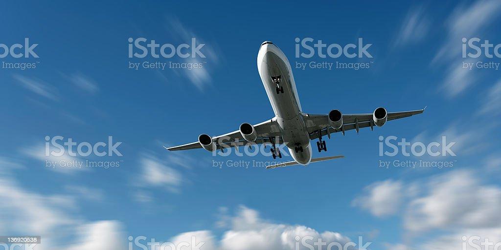 XL jet airplane landing in motion blur sky stock photo