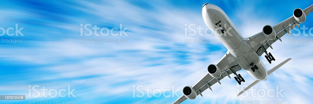 jet airplane landing in motion blur sky royalty-free stock photo