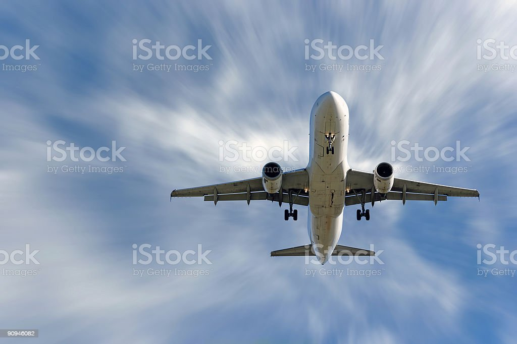 XXL jet airplane landing in motion blur sky stock photo