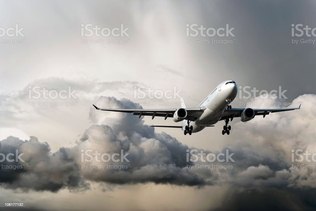 jet airplane landing in storm stock photo