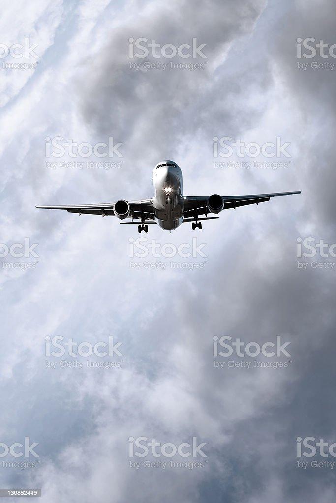 XXL jet airplane landing in storm royalty-free stock photo