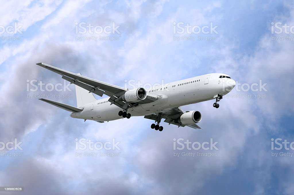 XXL jet airplane landing in storm stock photo