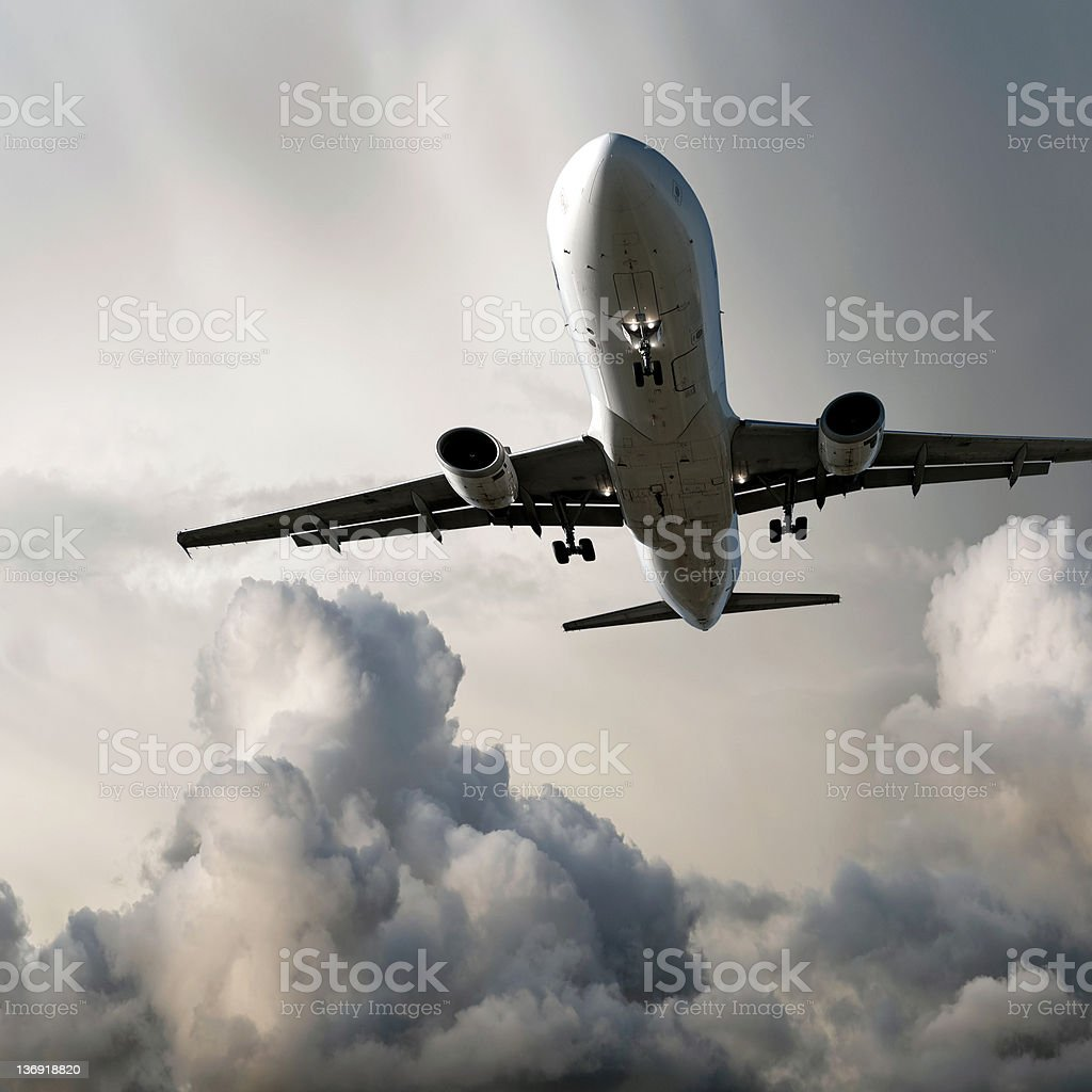 XL jet airplane landing in storm royalty-free stock photo