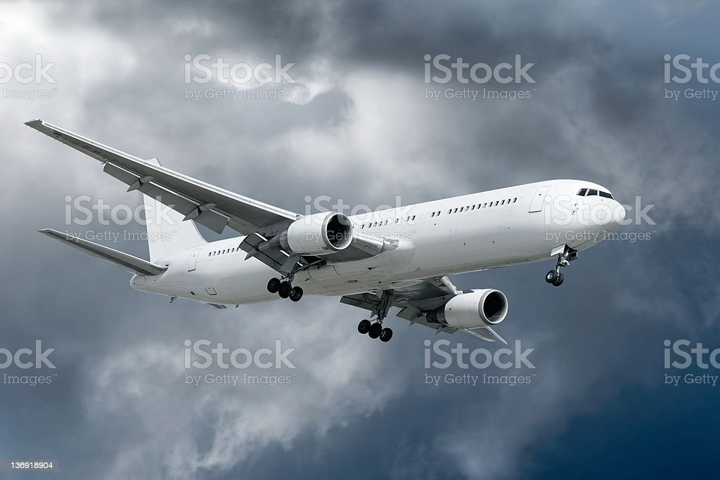 3XL jet airplane landing in storm royalty-free stock photo