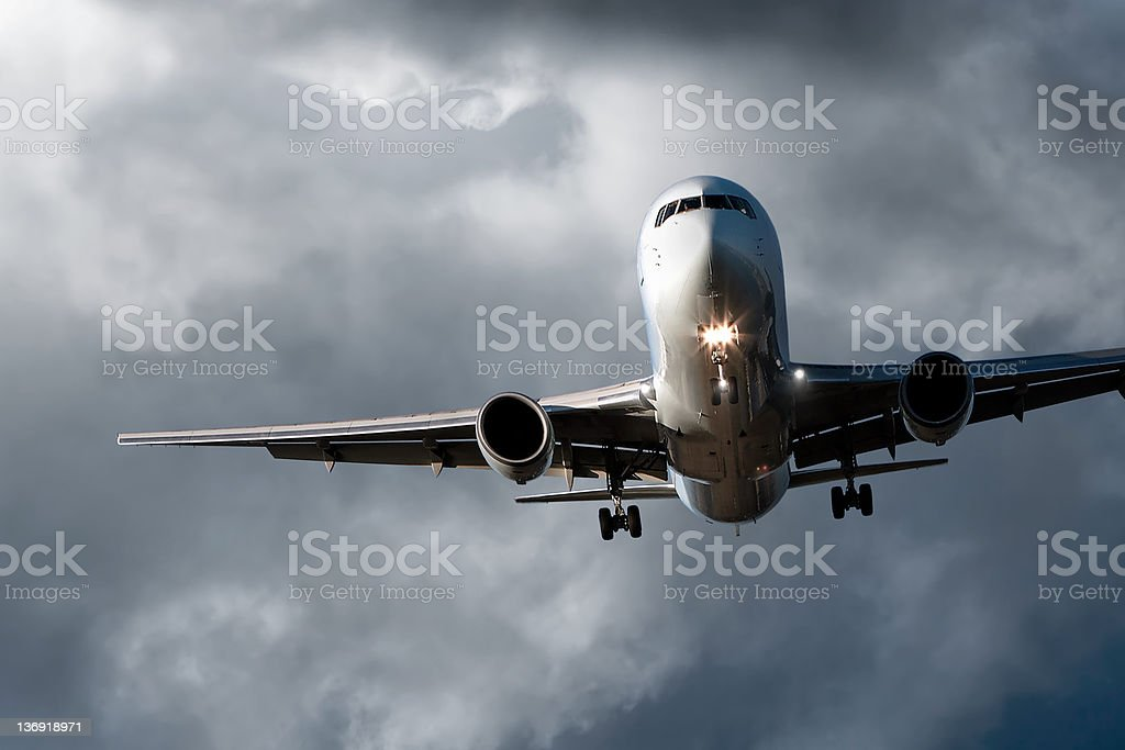 jet airplane landing in storm royalty-free stock photo