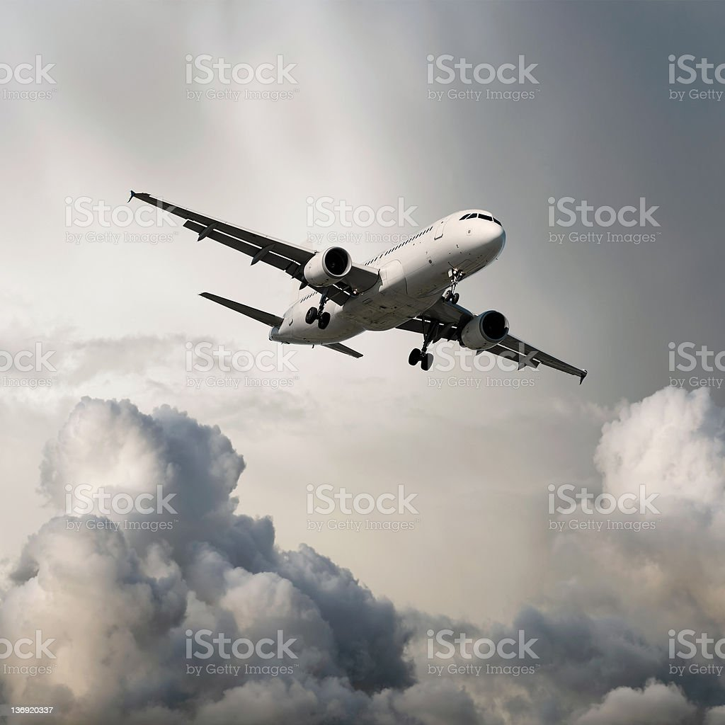 XXXL jet airplane landing in storm stock photo