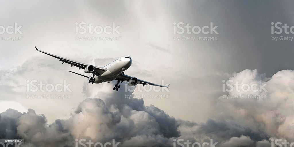 XL jet airplane landing in storm stock photo