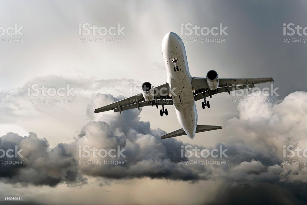 XXL jet airplane landing in storm stock photo