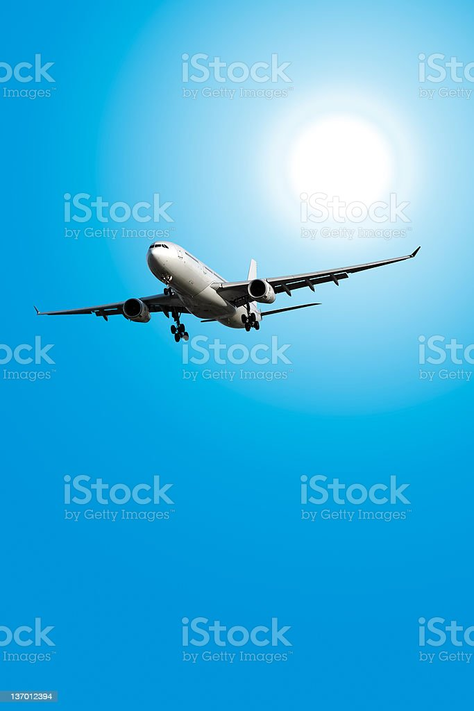 XXL jet airplane landing in sunny sky royalty-free stock photo