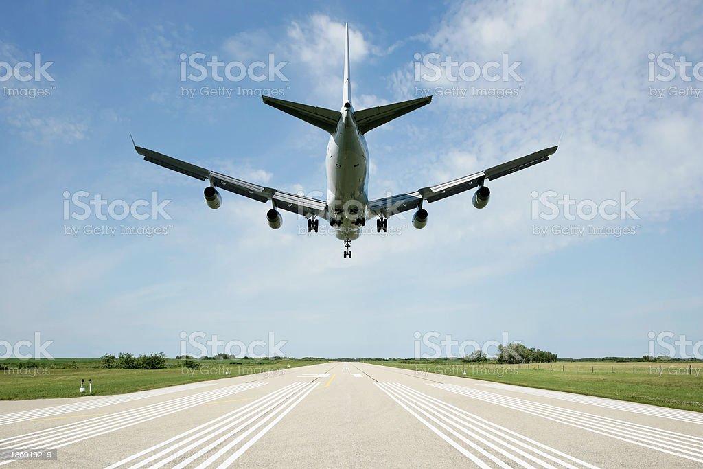 XXL jet airplane landing on runway royalty-free stock photo
