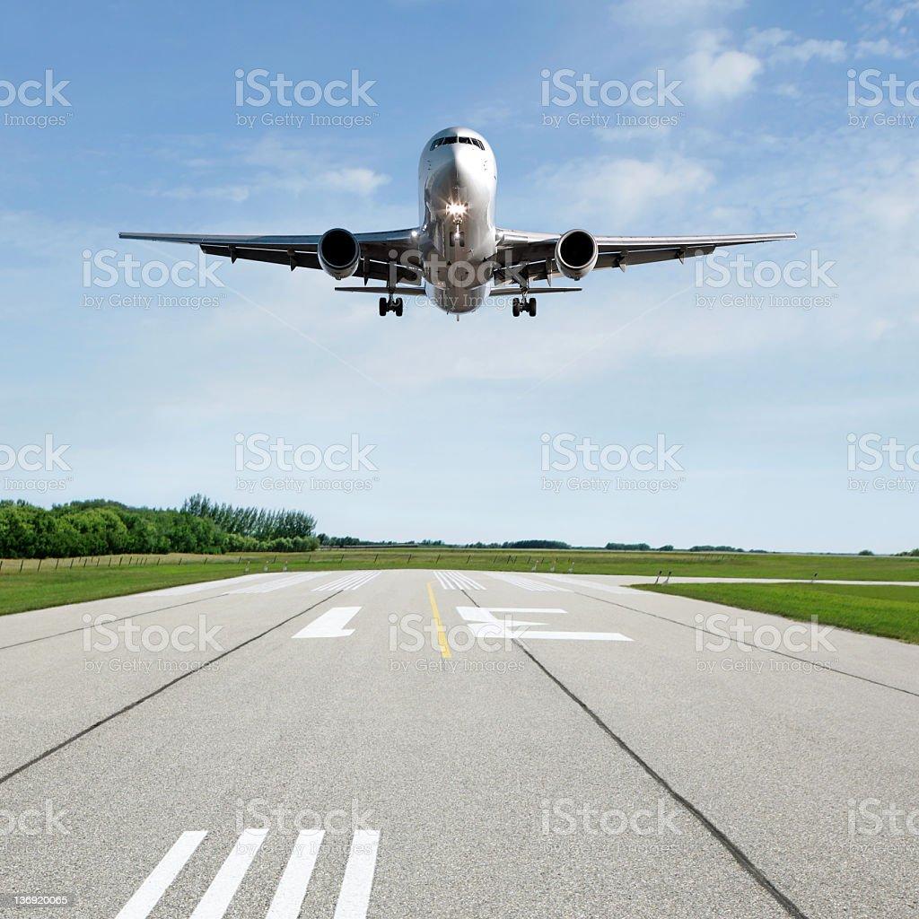 XL jet airplane landing on runway royalty-free stock photo