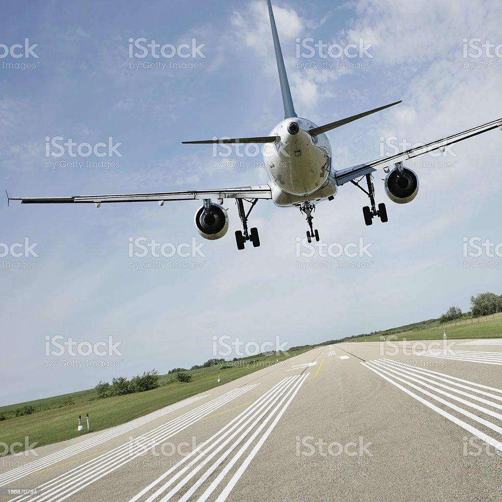 XL jet airplane landing on runway stock photo