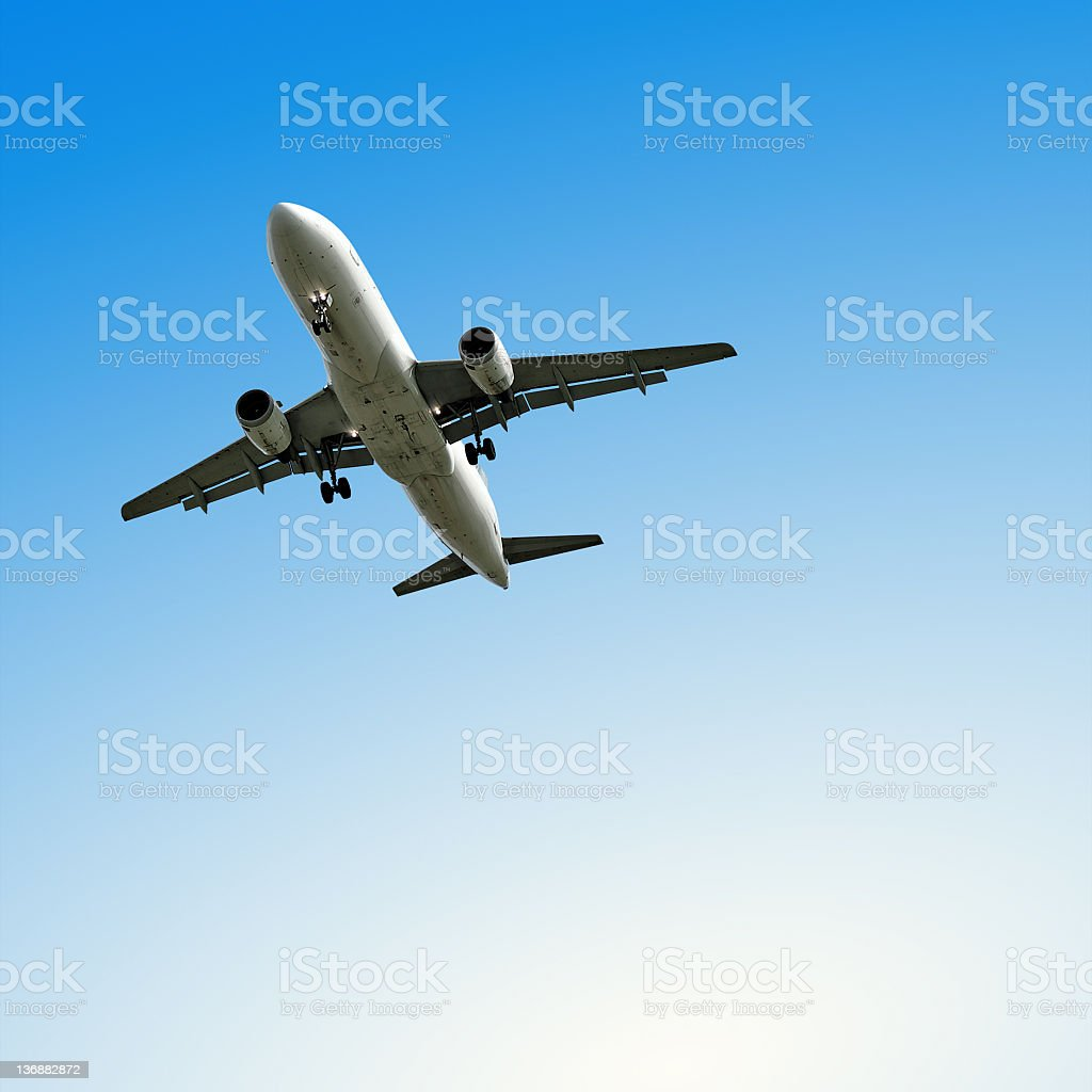 jet airplane landing with clear sky stock photo