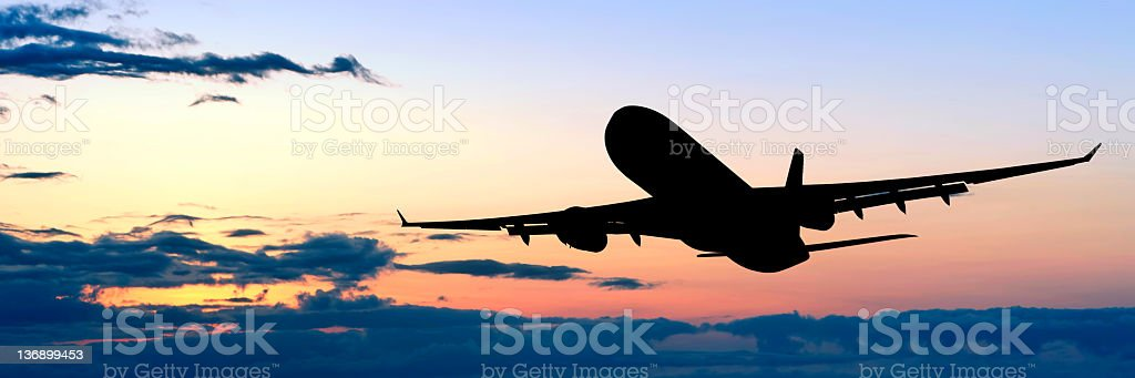 XL jet airplane taking off at dusk royalty-free stock photo