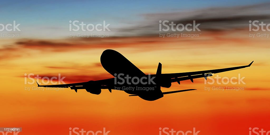 jet airplane taking off at dusk stock photo