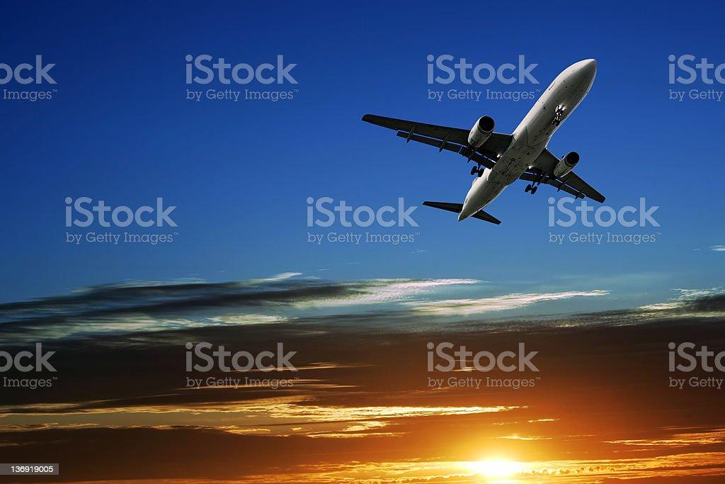 jet airplane taking off at sunset royalty-free stock photo