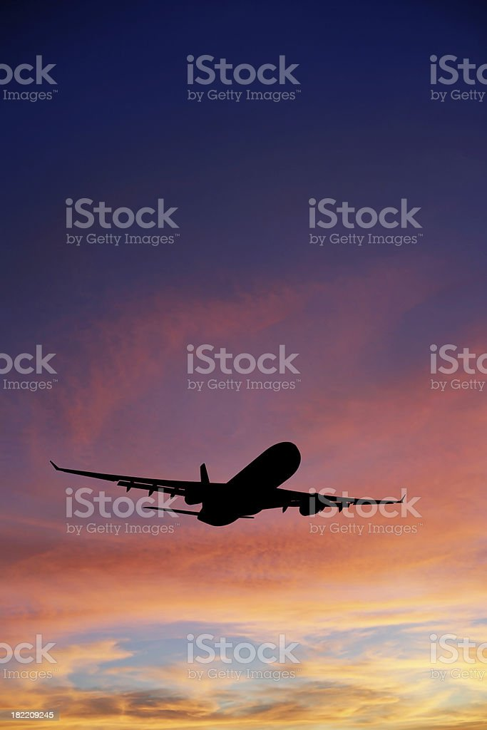 XXXL jet airplane taking off at sunset royalty-free stock photo