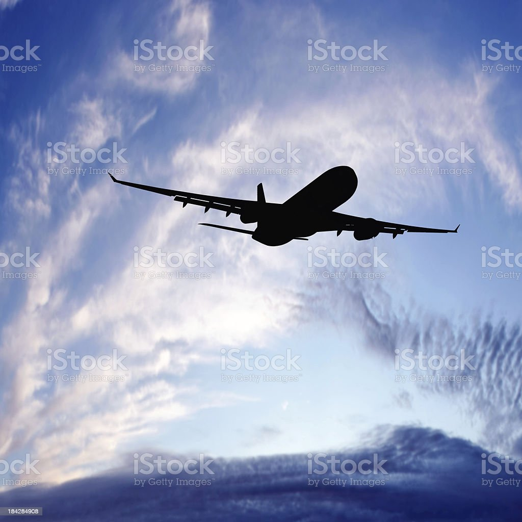XXL jet airplane taking off at sunset royalty-free stock photo