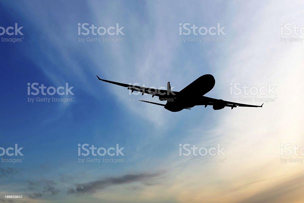 XXL jet airplane taking off at sunset stock photo