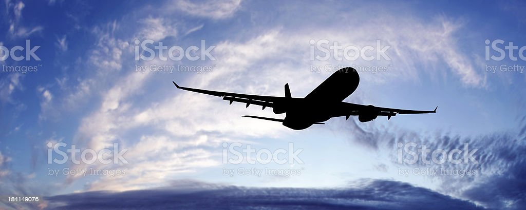 XL jet airplane taking off at twilight royalty-free stock photo