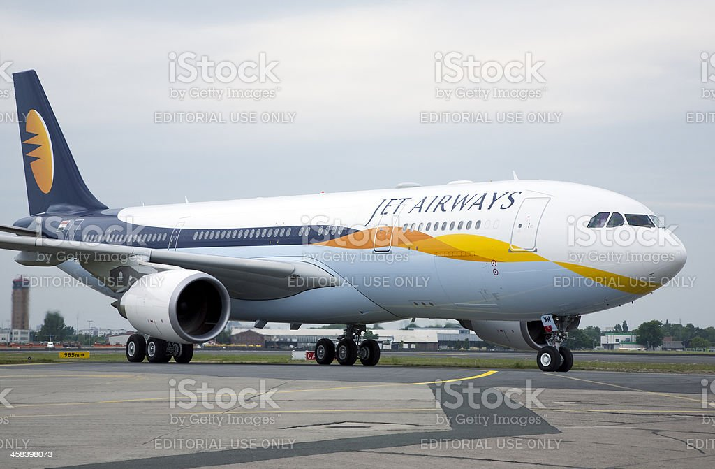 Jet Airways Airbus A330-200 plane taxis at Berlin-Schoenefeld Airport stock photo