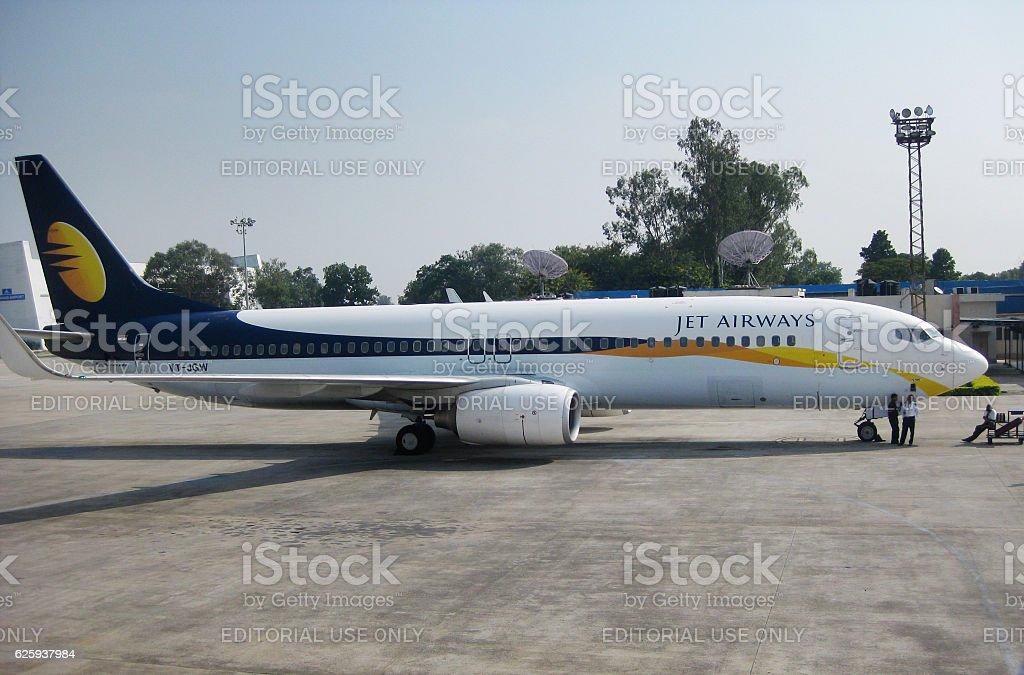 Jet Airways plane parked at Varanasi Airport stock photo