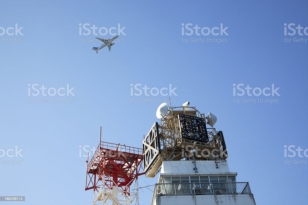 Jet and Control tower royalty-free stock photo