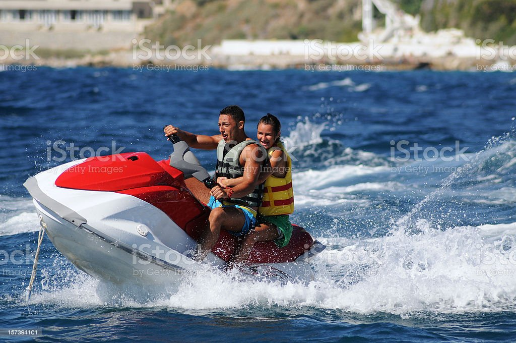 Jet boat in the lake with couple stock photo