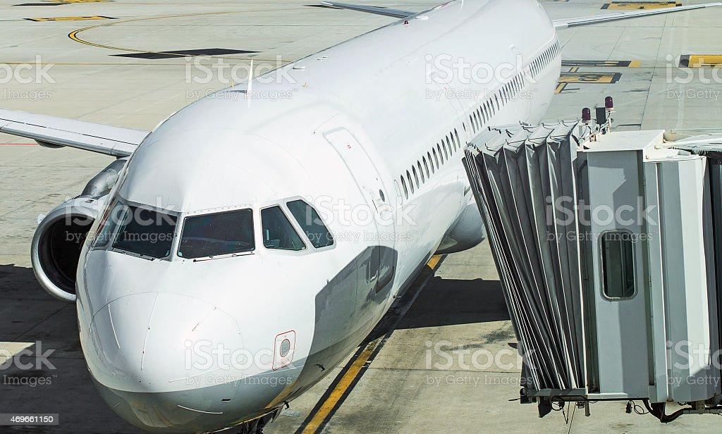 Jet bridge docked to the plane. stock photo