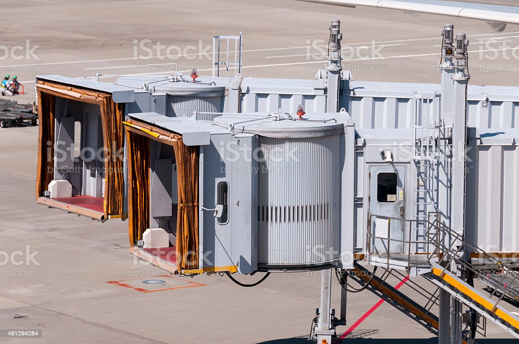 Jet bridges waiting for airplane at airport stock photo