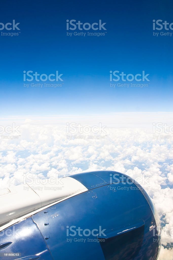 Jet Engine above the clouds stock photo