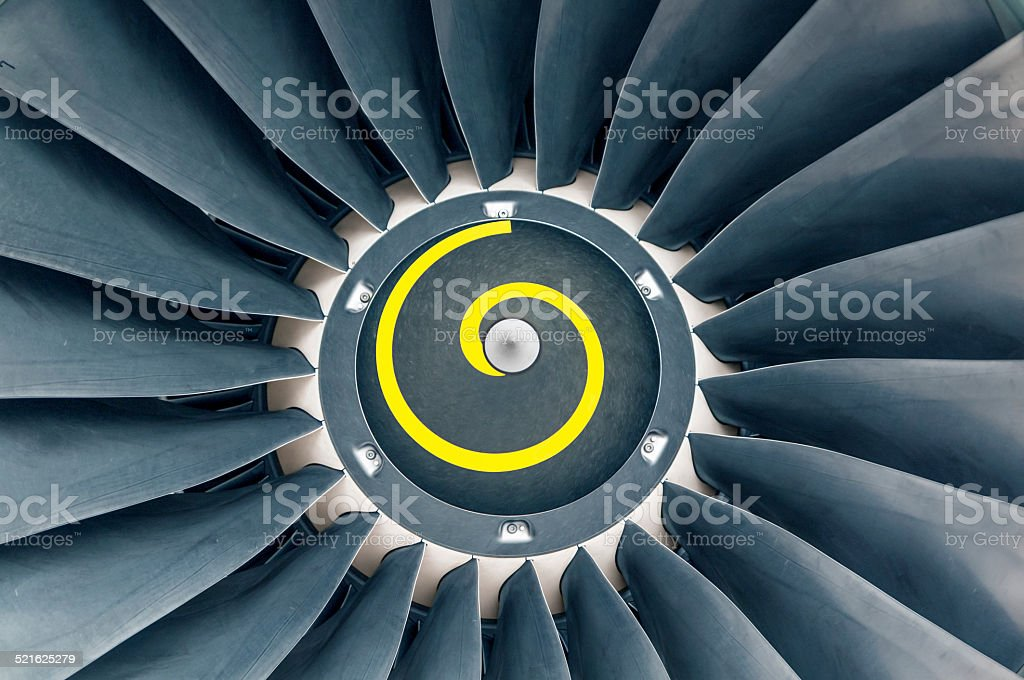 Jet engine front with yellow spiral stock photo