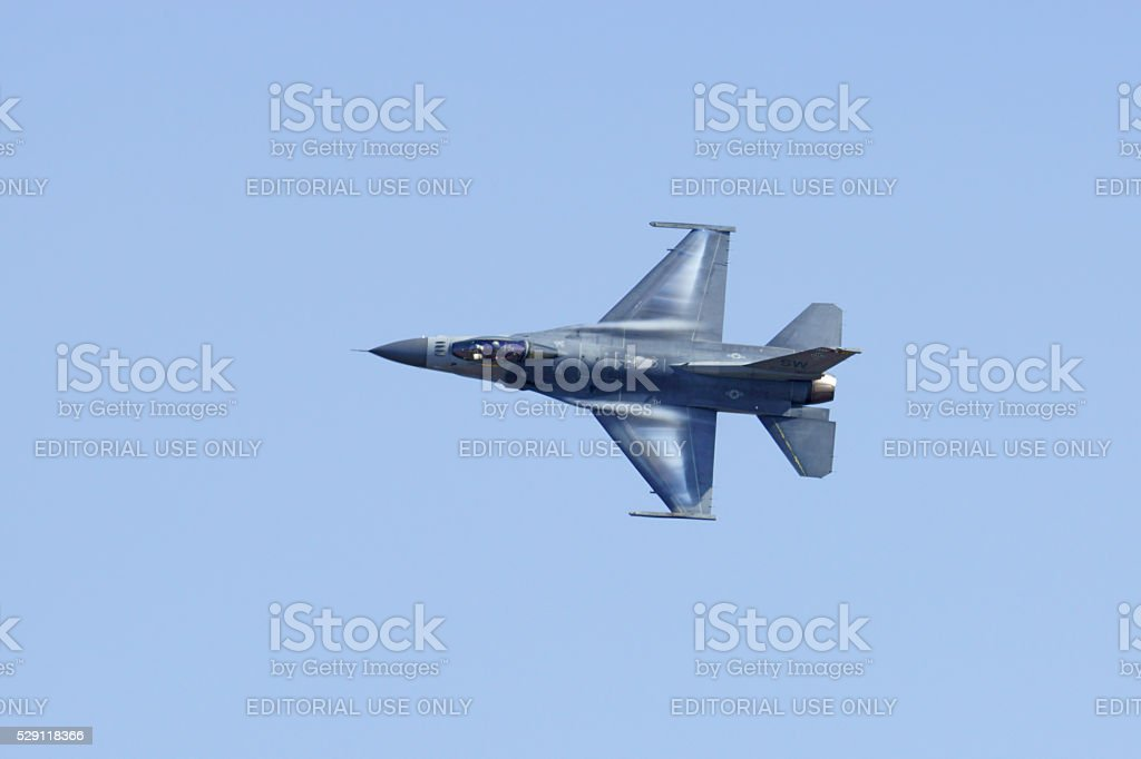 Jet F-16 fighter aircraft flying stock photo
