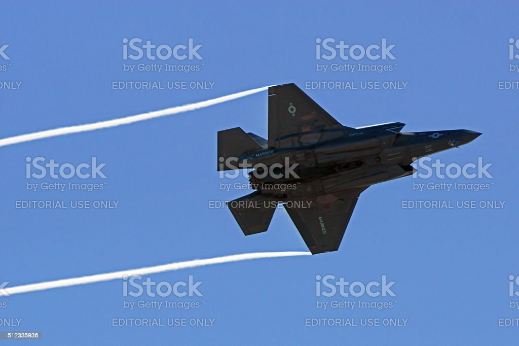 Jet F-35 Lightning streaks across sky stock photo