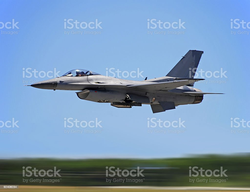 Jet fighter on high speed pass stock photo