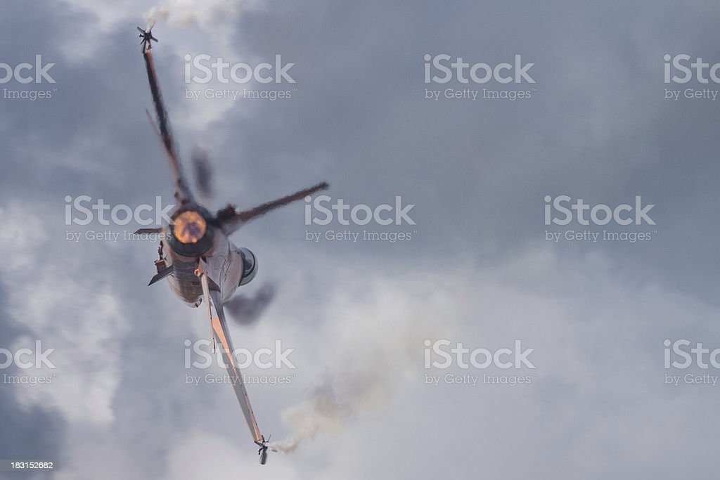 Jet fighter with afterburner stock photo