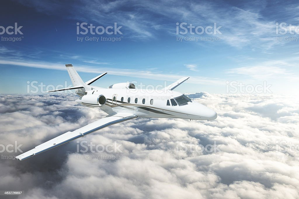 jet flying above the sky stock photo