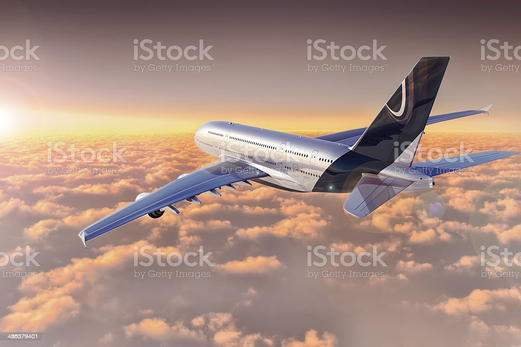 Jet flying over cloudscape at sunset stock photo