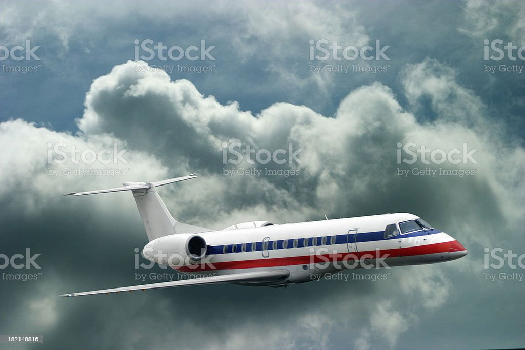 Jet in Cloudy Sky royalty-free stock photo